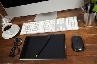 Office desk with pc, mobile phone and belongings