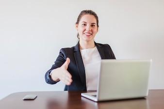 Office worker giving handfor shake