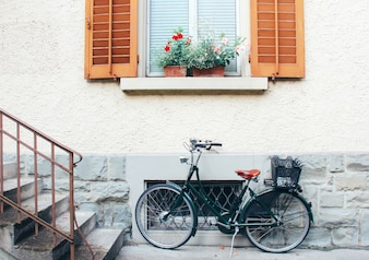Old bicycle parking front of door house