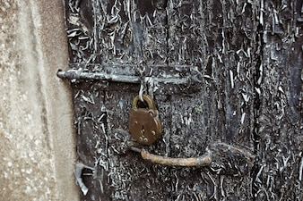 Old door with paint peelings and lock
