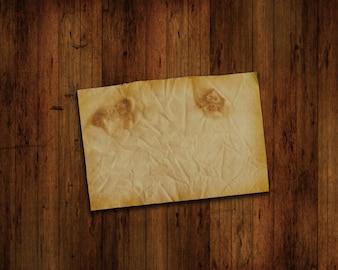 グランジ木の壁に紙の旧作品
