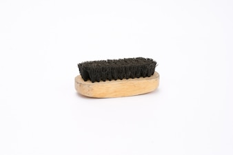 Old shoe brush with wooden handle