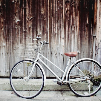 Old vintage bicycle leaning against grunge wall