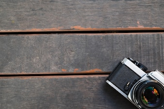 Old vintage camera on wooden background