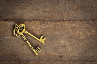 Old vintage key on wood background with space