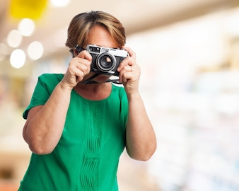 Older woman taking a picture