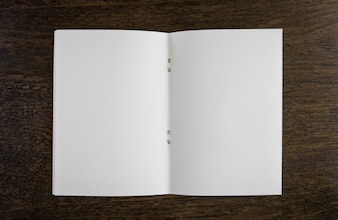 Open blank book on a wooden table