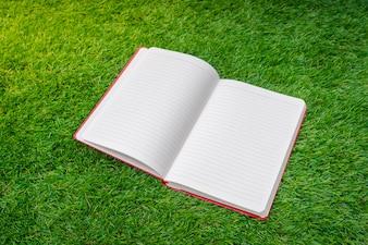 Open notebook on grass