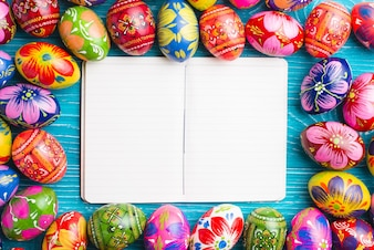 Open notebook surrounded by colorful easter eggs