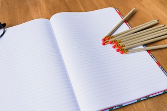 Open notebook with pencils on it