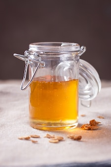Opened jar with honey