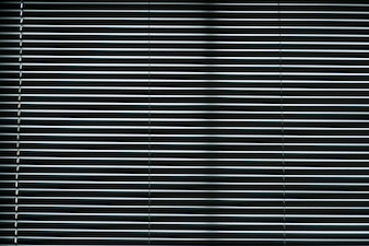Opened metallic window shutter at the office building, innovation technique light control.Aluminum louver for texture