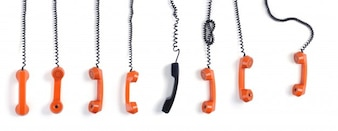 Orange and black phones on white background