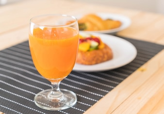 Orange juice with spinach croissant and mixed fruits danish