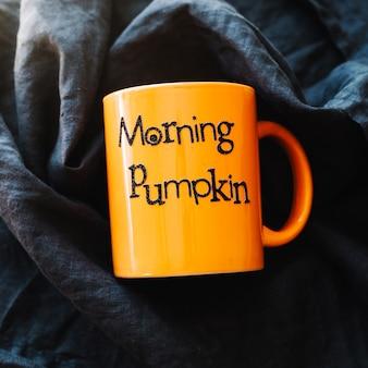 Orange mug with writing
