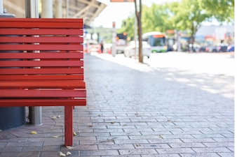 Outdoor red wooden benches