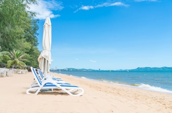 Outdoor with umbrella and chair on beautiful tropical beach and sea
