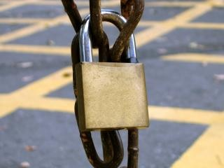 Padlock on a Rusty Chain
