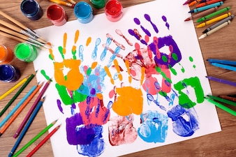 Painted handprints with artistic equipment