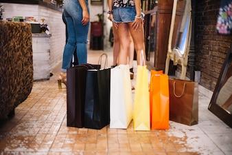 Paper bags standing on shop floor