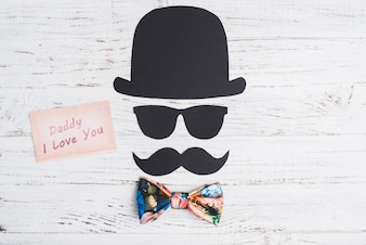 Paper character with mustache, hat and glasses for father's day