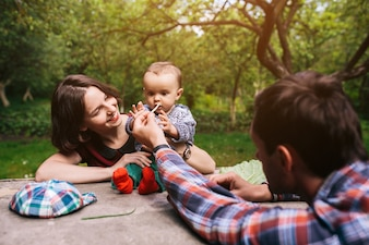 Parents with infant child in park
