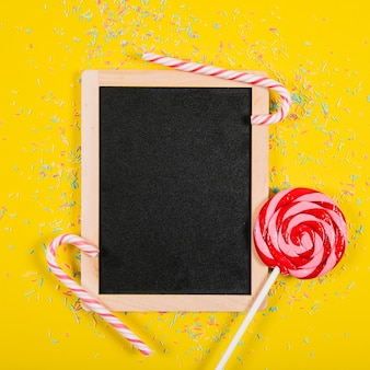 Party composition with slate and candy canes