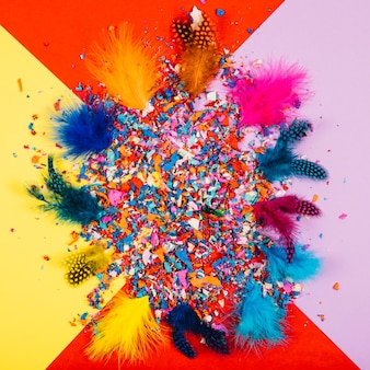 Party decoration with confetti and feathers