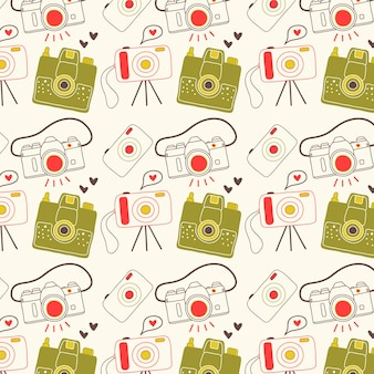 Pattern with hand drawn retro cameras