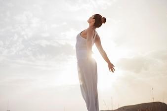 Peaceful woman taking a deep breath