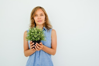 Peaceful Young Beautiful Woman Holding Pot Plant
