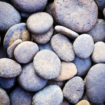 Pebble stone background for spa with retro filter effect