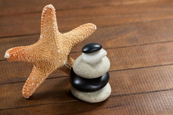 Pebble stones with star fish