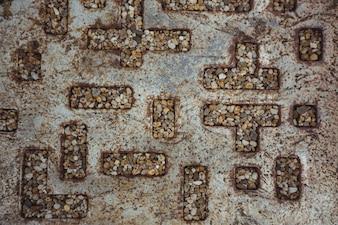 Pebbles in hollow metal pattern