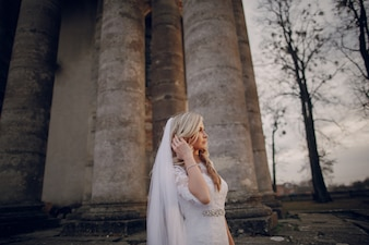 Pensive bride with columns background