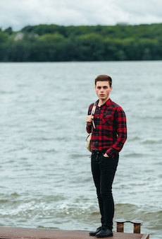 Pensive teen with lake background