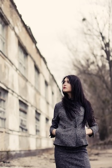 Pensive woman with long hair in a fall day