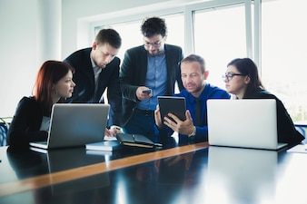 People working with devices in office
