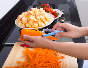 Person cutting carrots