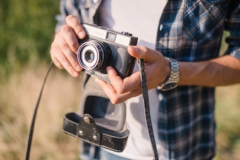 Person holding an old camera