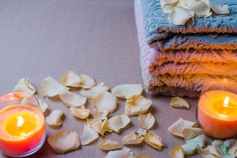 Petals and candles with towels