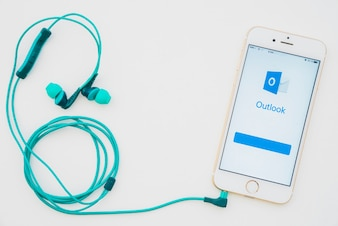 Phone with outlook app and earphones
