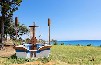 Photo of a sailor boat on a beach in protaras, Cyprus island