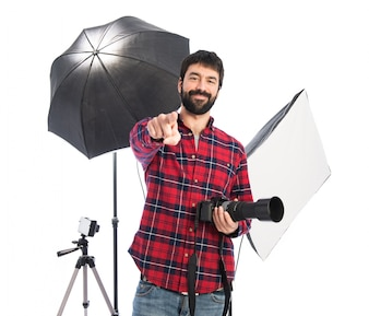 Photographer pointing to the front