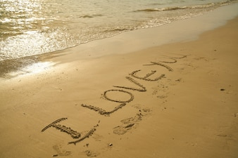 Phrase  i love you  written in the sand