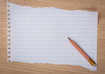 Piece of notebook paper with a pencil
