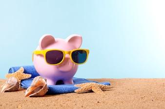 Piggy bank on a beach