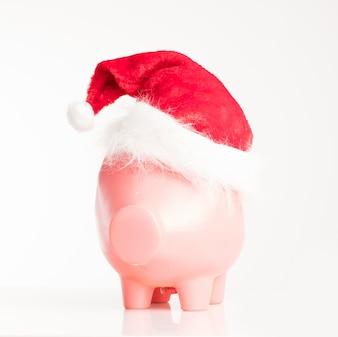 Piggy bank with a santa hat