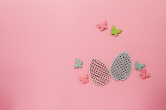 Pink background with butterflies and eggs for easter