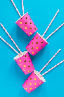 Pink cups with straws